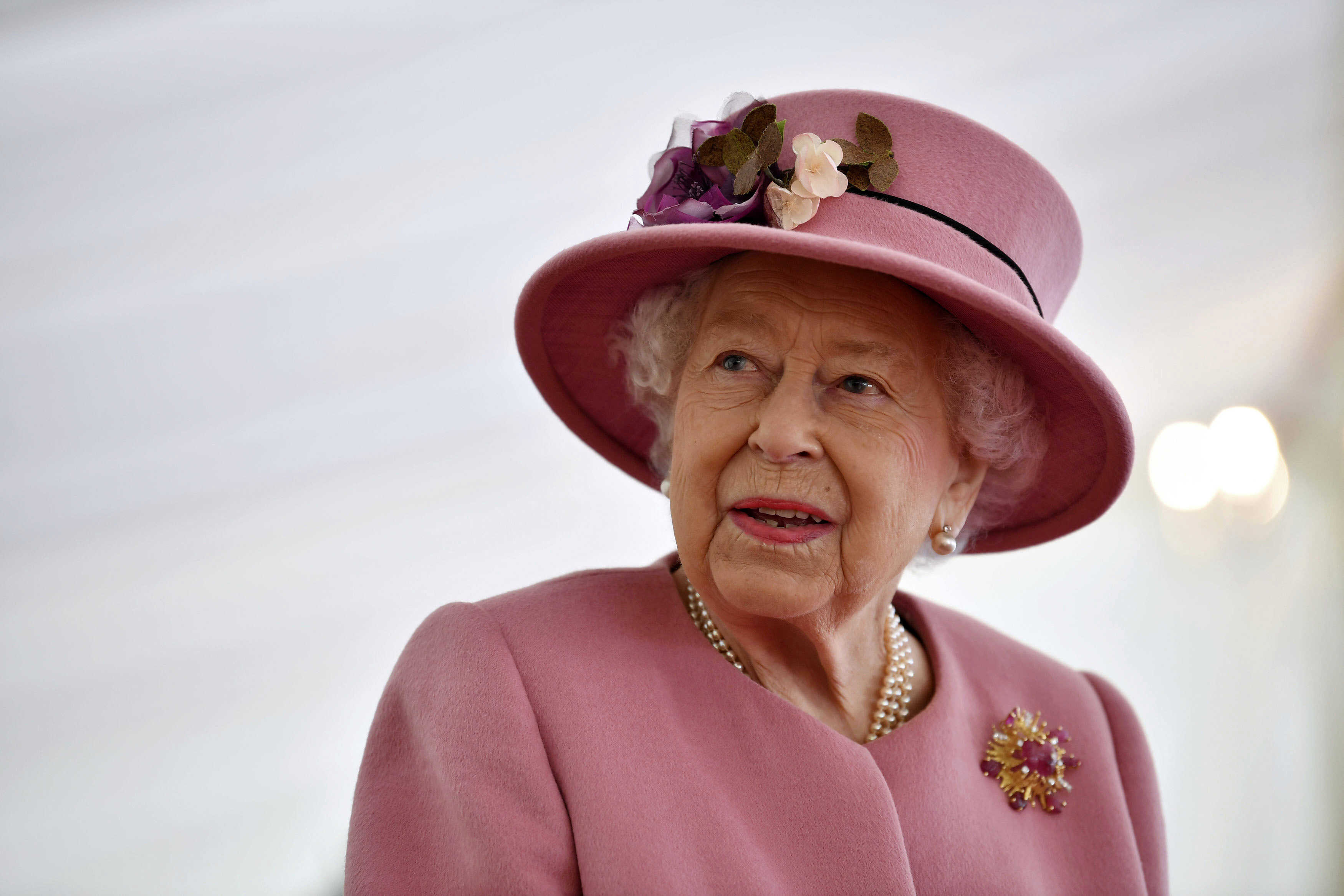 Britain's Queen Elizabeth II visits the Defence Science and Technology Laboratory (DSTL) at Porton Down, England, Thursday Oct. 15, 2020, to view the Energetics Enclosure and display of weaponry and tactics used in counter intelligence.
