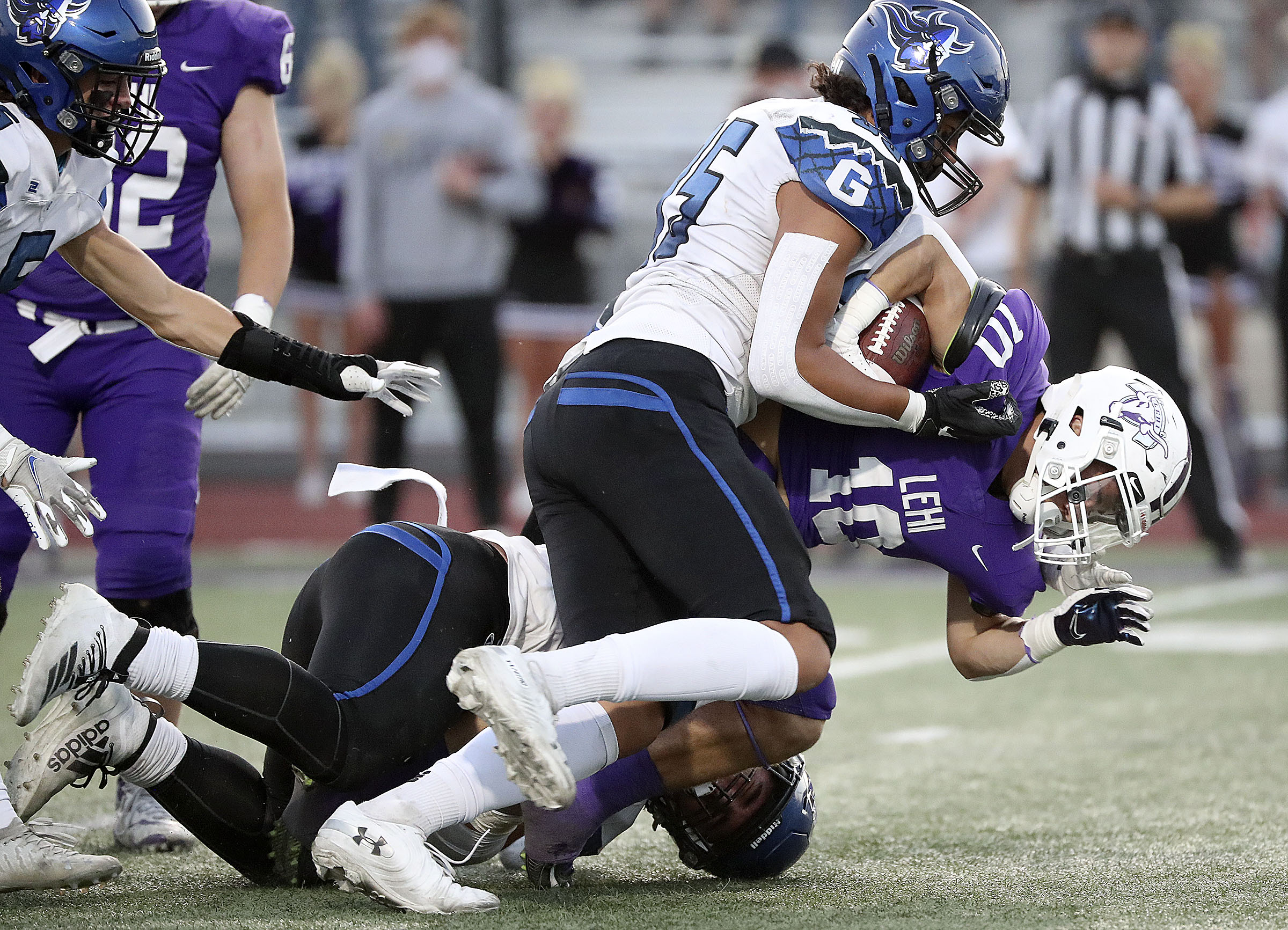 Pleasant Grove's Isaac Vaha tackles Lehi's Chandler Jenkins during a football game at Lehi High School in Lehi on Friday, Sept. 11, 2020.