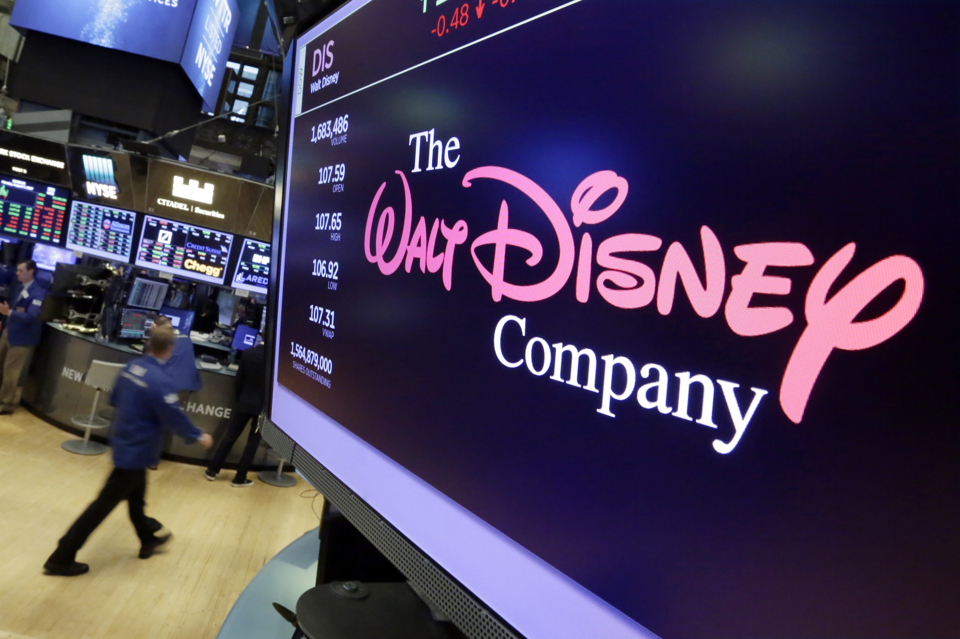 """In this Aug. 8, 2017, file photo, The Walt Disney Co. logo appears on a screen above the floor of the New York Stock Exchange. The Walt Disney Co. has """"dramatically"""" slashed its advertising budget on Facebook and Facebook-owned Instagram, according to a report in the Wall Street Journal."""