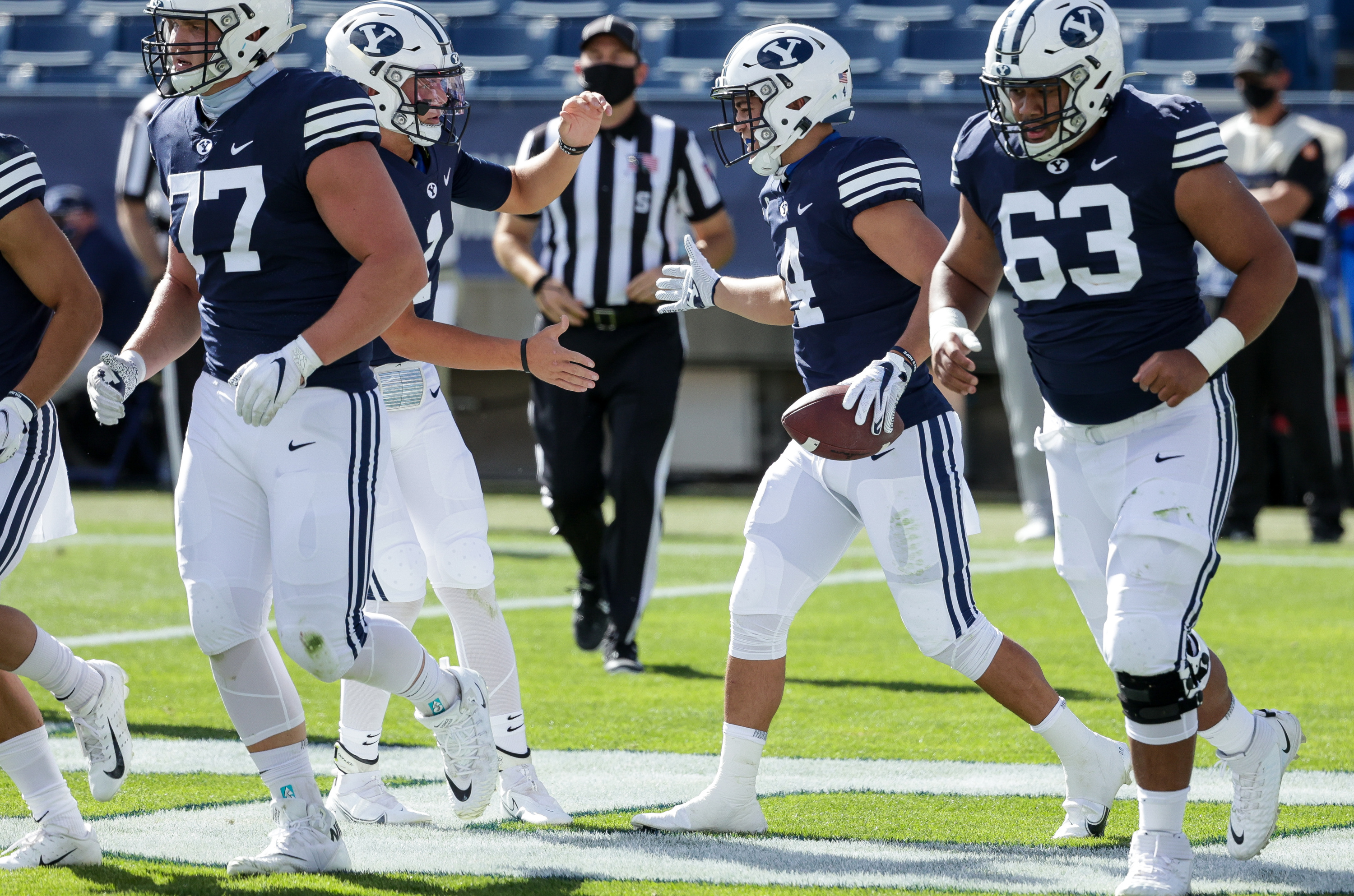 Brigham Young Cougars quarterback Zach Wilson (1) and running back Lopini Katoa (4) celebrate after Katoa caught the ball for a touchdown, giving the Cougars a 14-3 lead over the UTSA Roadrunners after the PAT, at LaVell Edwards Stadium in Provo on Saturday, Oct. 10, 2020.