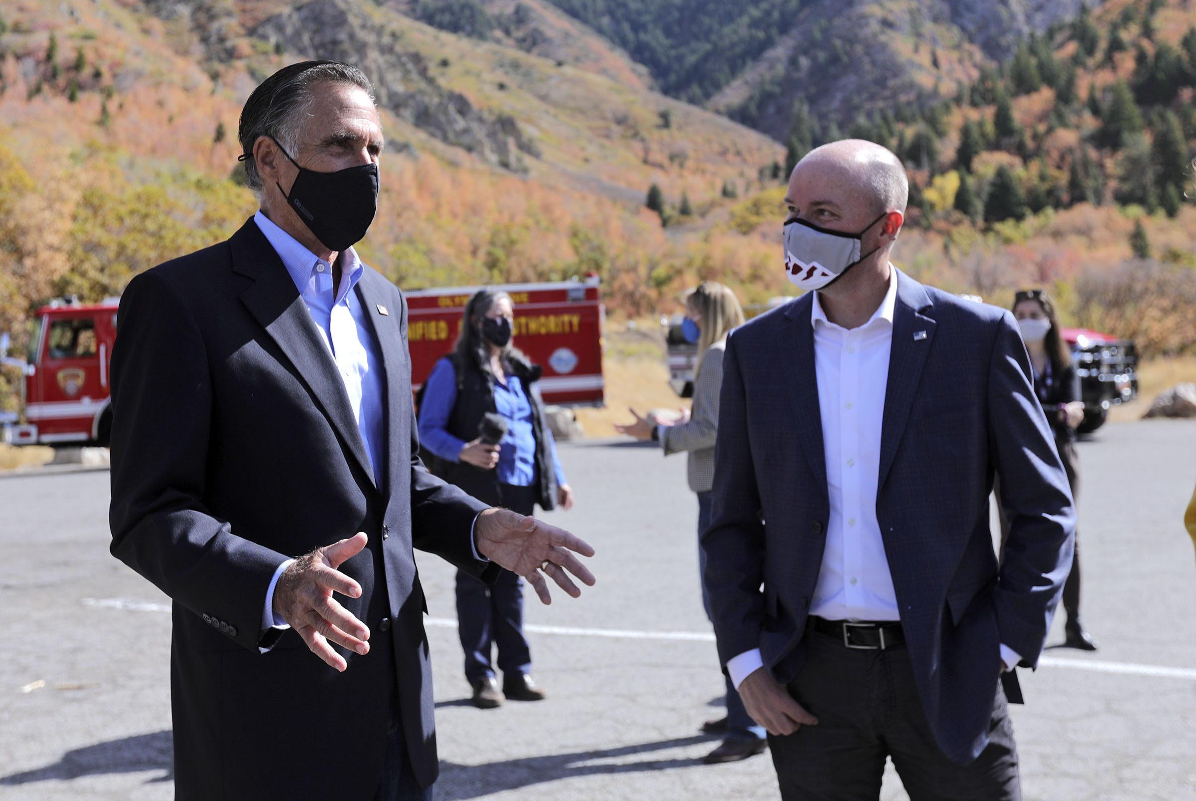 Sen. Mitt Romney, R-Utah, talks with Lt. Gov. Spencer Cox after a press conference announcing Romney's plan to establish a wildfire commission, to review national wildfire policies and make recommendations to Congress, at the Neff's Canyon trailhead in Millcreek on Thursday, Oct. 15, 2020. A recent wildfire in Neff's Canyon is 100% contained but still smoldering.