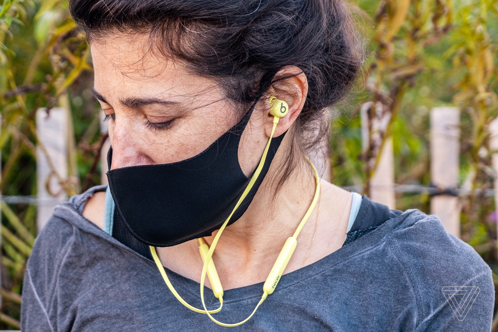 Apple's new Beats Flex earbuds, pictured in yellow.