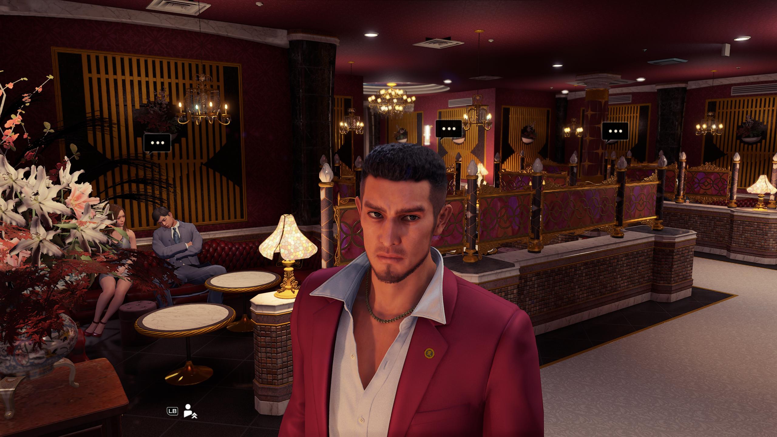 Yakuza: Like a Dragon protagonist Ichiban standing inside of a maid café