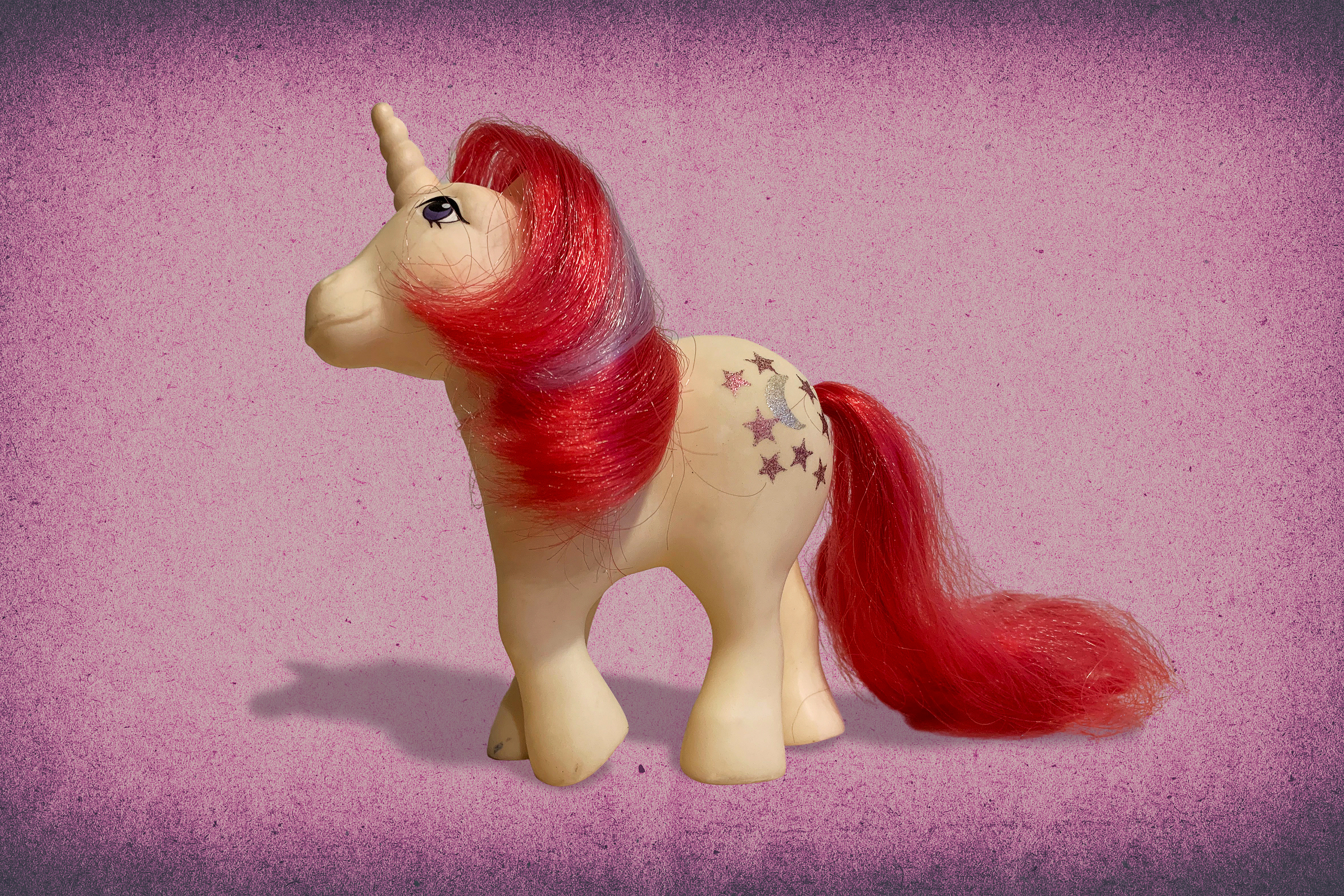 """My Little Pony"" toy on pink mottled background"