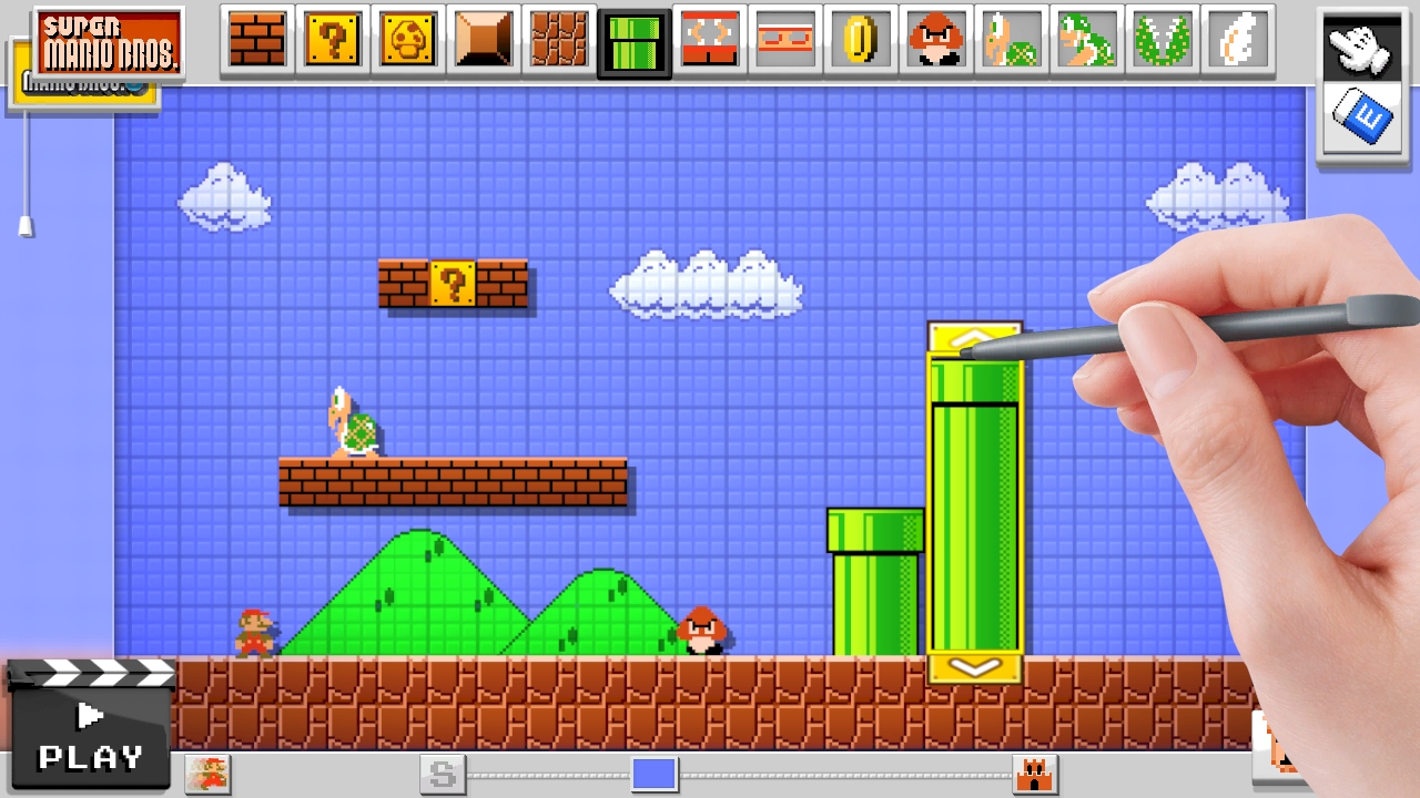 A screenshot of Super Mario Maker on Wii U with a hand holding a stylus