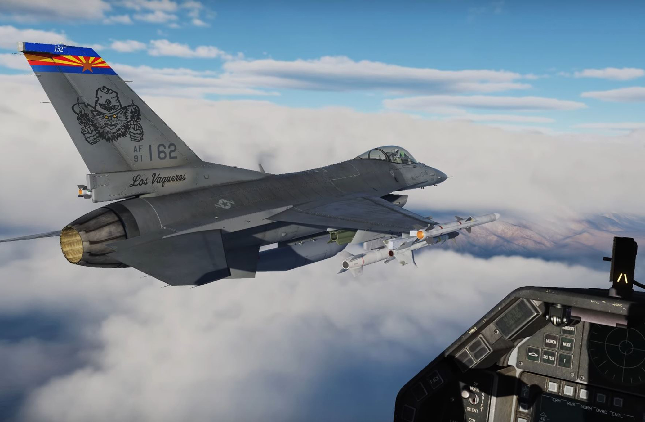 An F-16 in formation, viewed form inside the cockpit of the trailing edge of the formation.
