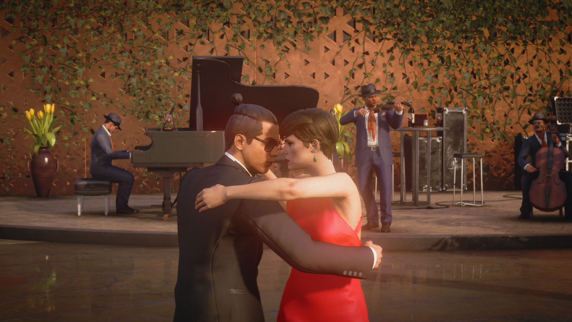 a man wearing a suit and sunglasses dances a tango with a woman in a red dress in Hitman 3
