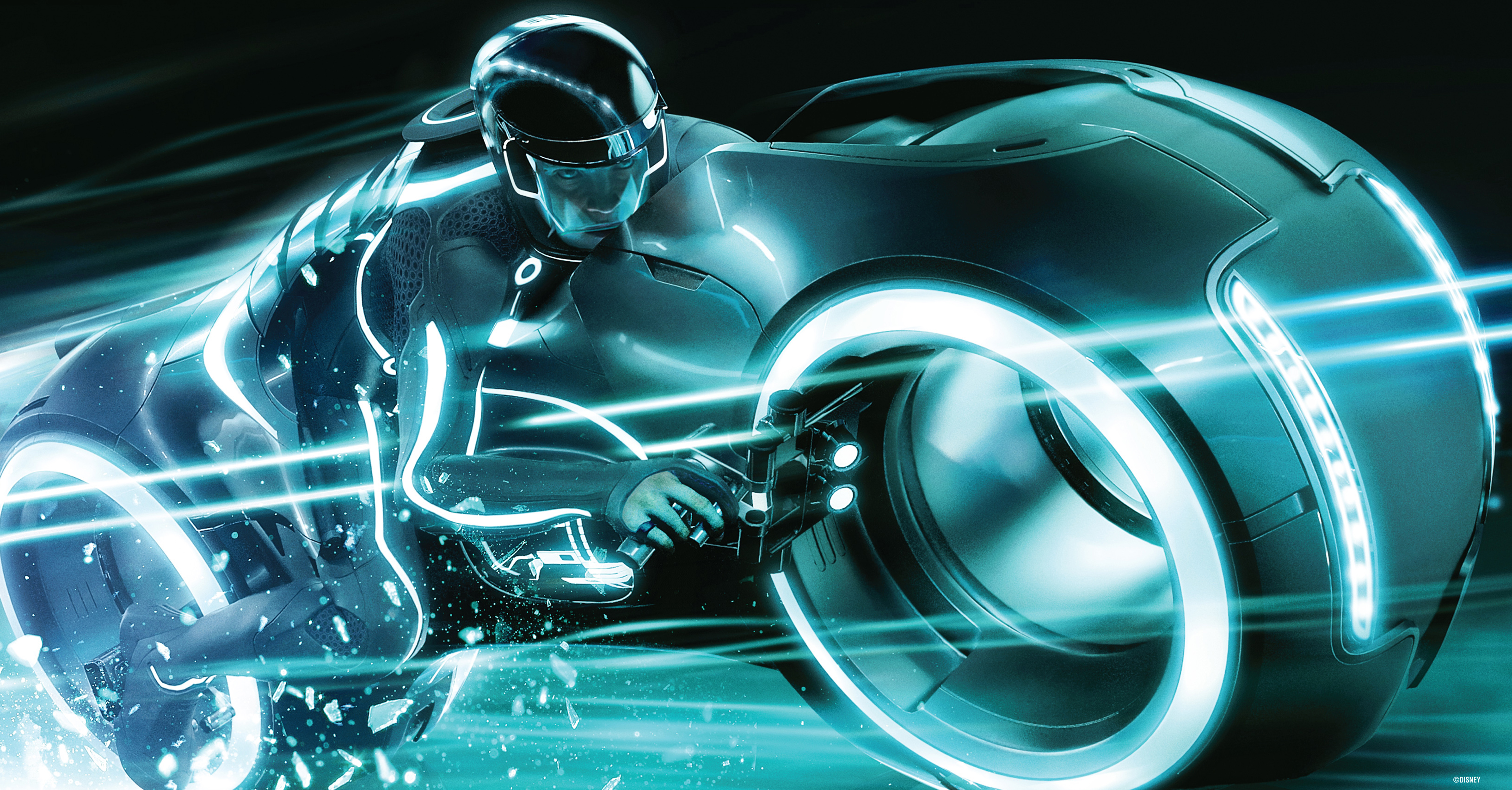 Sam Flynn rides a lightcycle in a still from Tron: Legacy