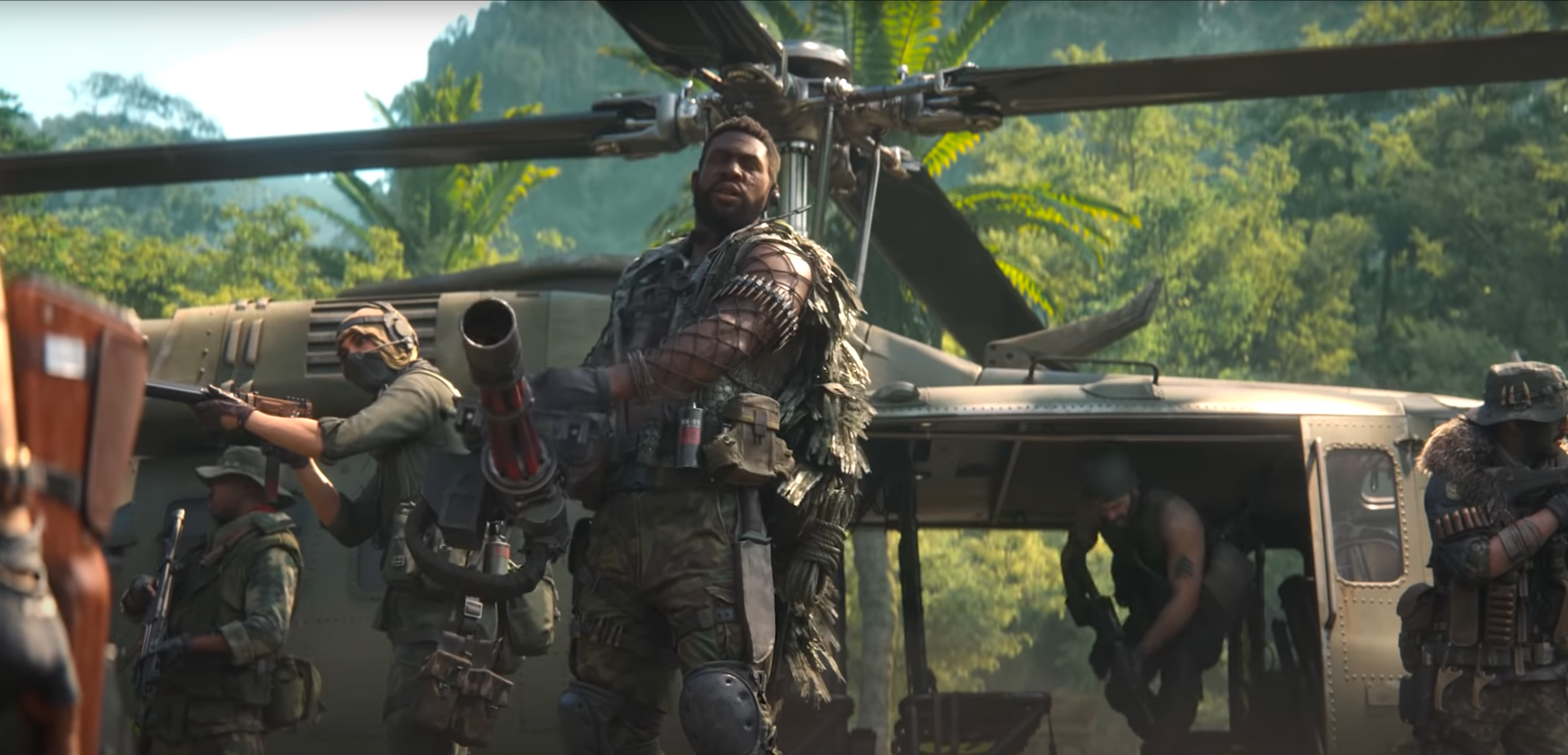 A new Call of Duty: Black Ops Cold War Operator stands in front of a helicopter with a minigun