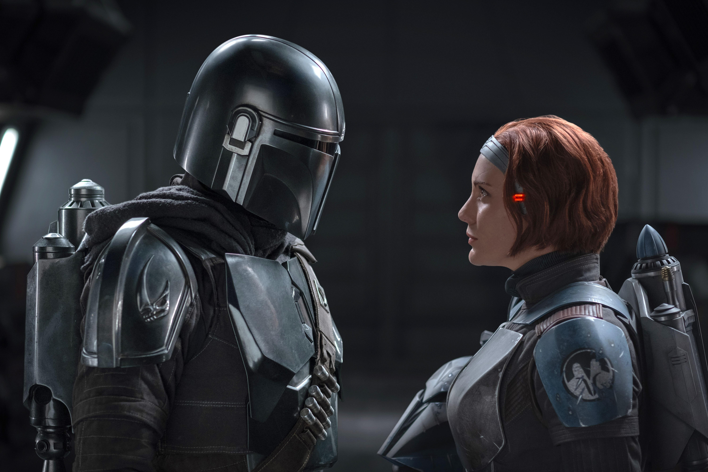 Pedro Pascal, in costume as The Mandalorian Din Djarin, and Katee Sackhoff as Bo-Katan Kryze.