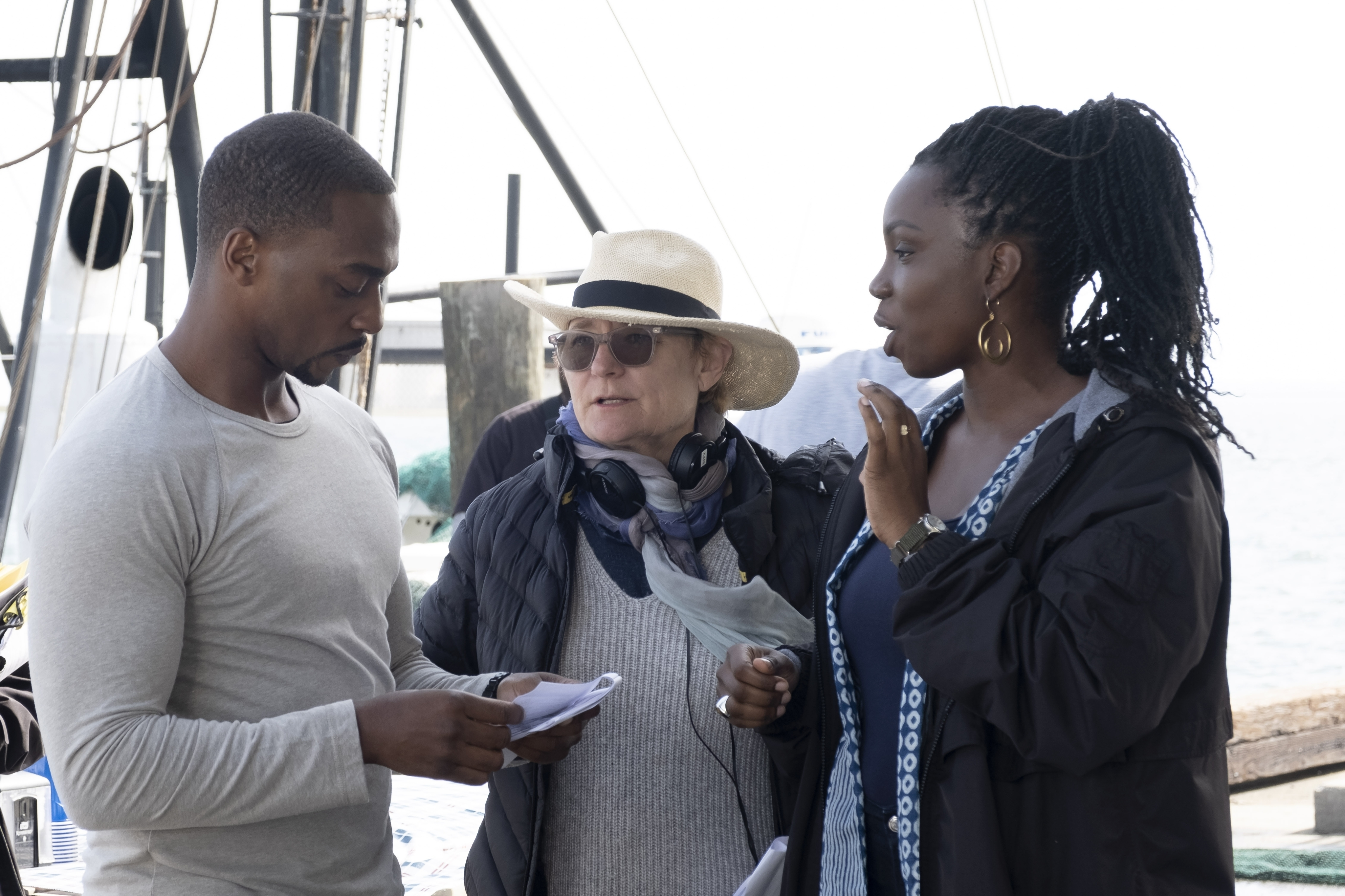 Director Kari Scogland stands between Anthony Mackie and Adepero Oduye on the set of Falcon and the Winter Soldier
