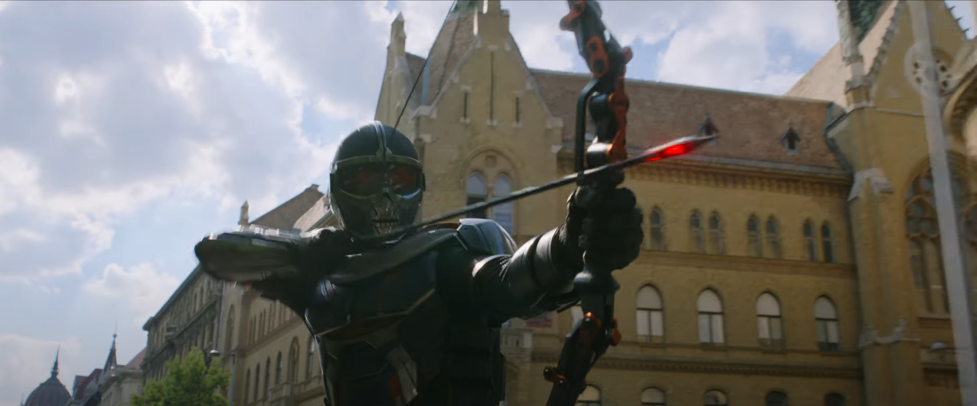 Taskmaster from the Black Widow movie shooting an explosive arrow out of a vehicle