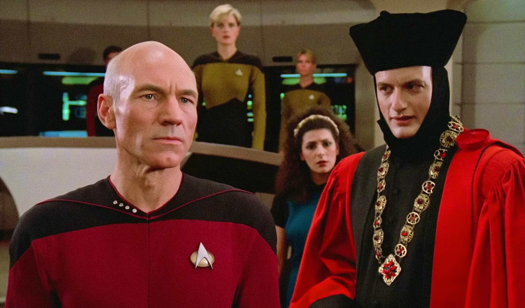 """John de Lancie in his judge costume from the Star Trek: The Next Generation episode """"Encounter at Farpoint"""" faces Jean-Luc Picard"""