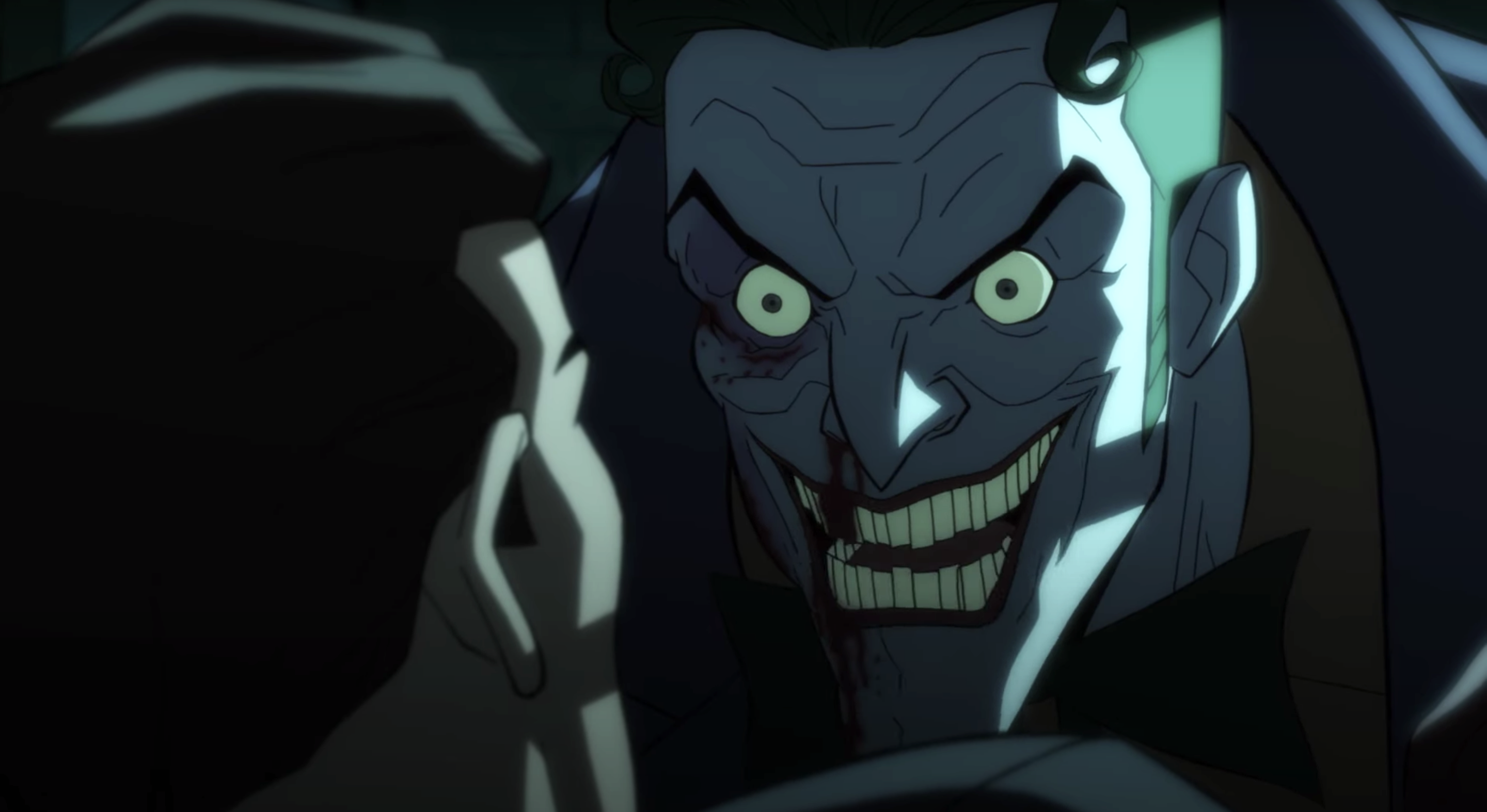 The Joker grins maniacally at a victim in The Long Halloween movie.