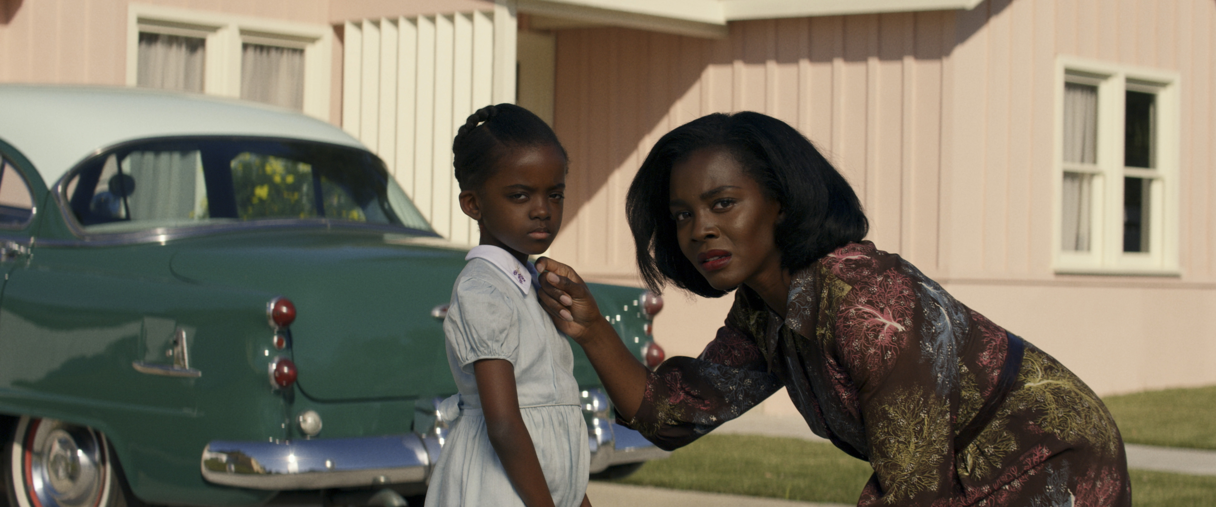 Deborah Ayorinde bends down to address her daughter, played by Melody Hurd, with a 1950s car in the background, in Amazon Studios' Them