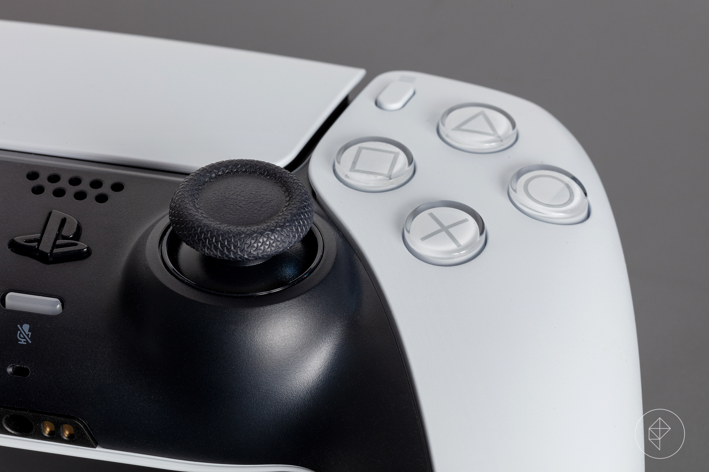 A close up photo of the face buttons on the Dualsense controller