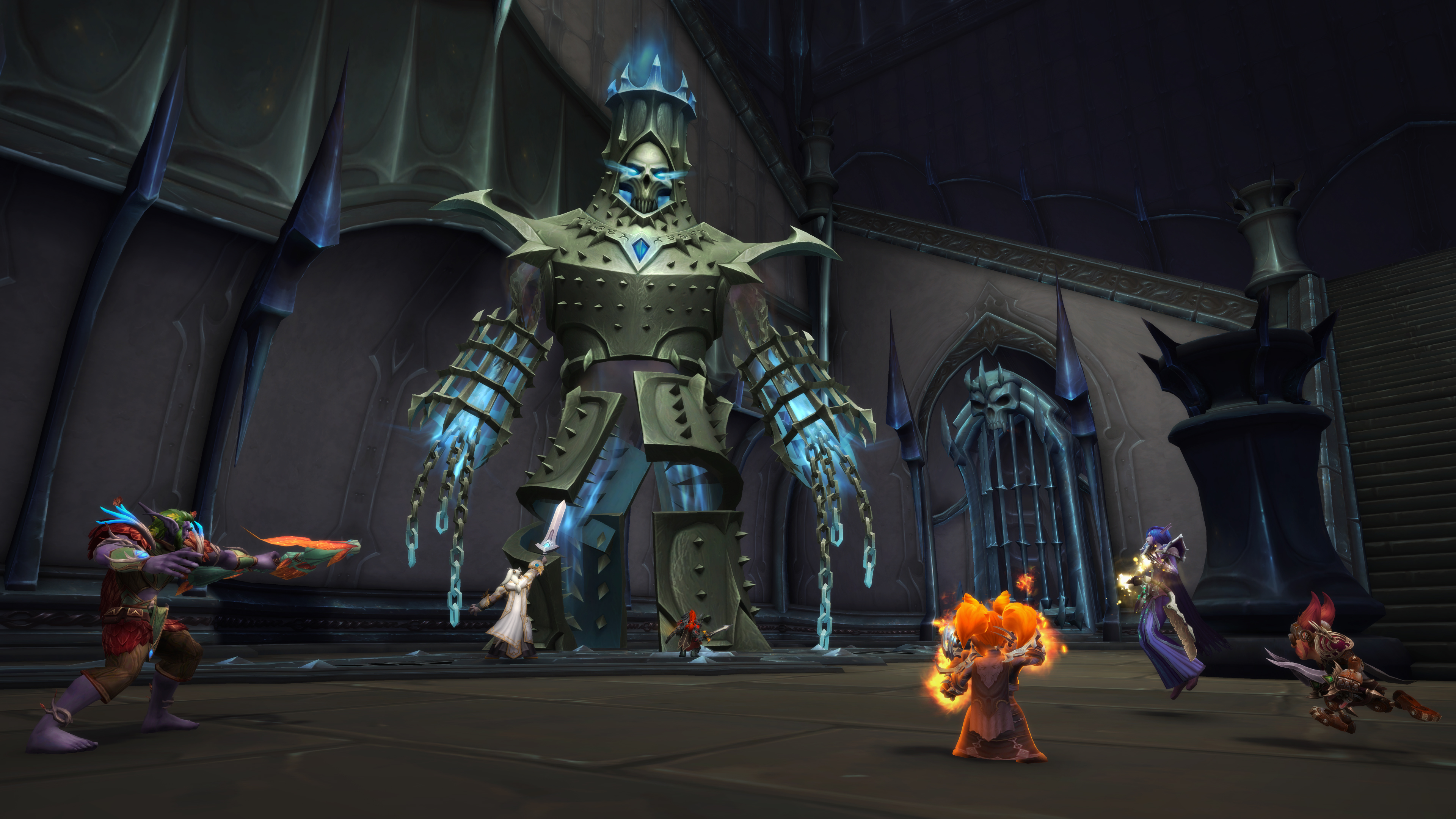 World of Warcraft - A group of players attacks a giant, armored minion of the nefarious Jailer in The Maw.