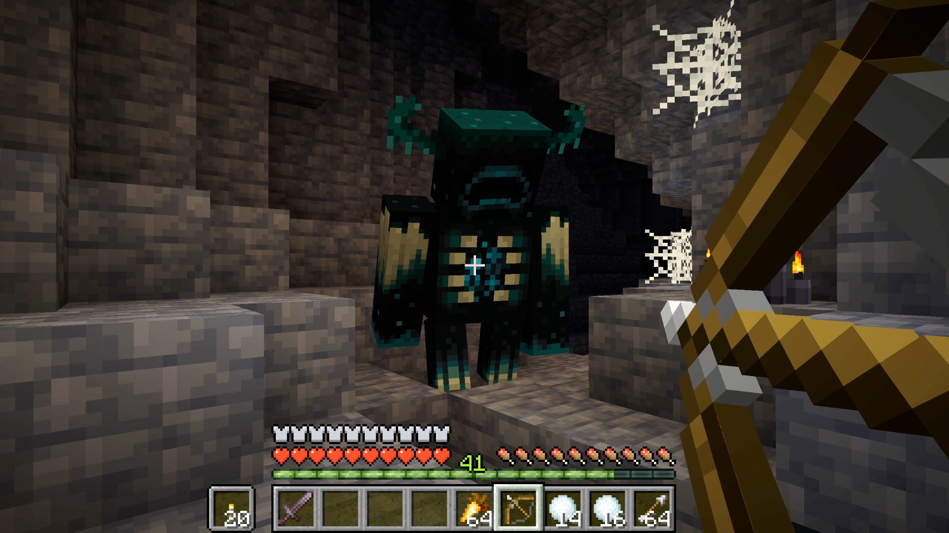 Minecraft - a spooky Warden shows up in a cave underground.