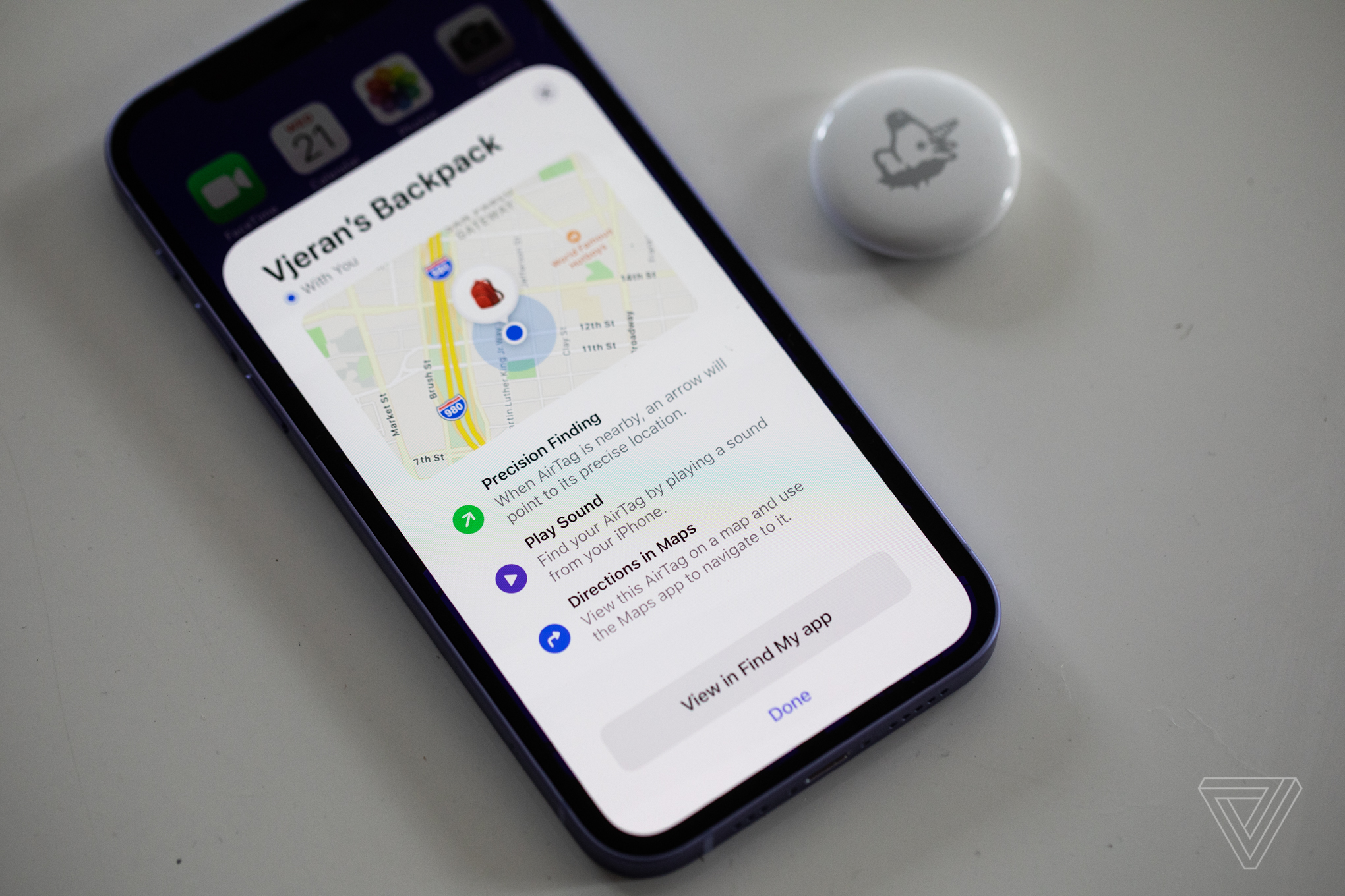 An AirTag and the Find My app