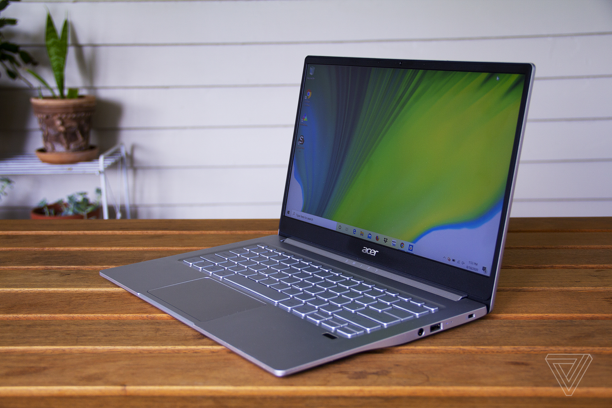 The Acer Swift 3 sits on a table.