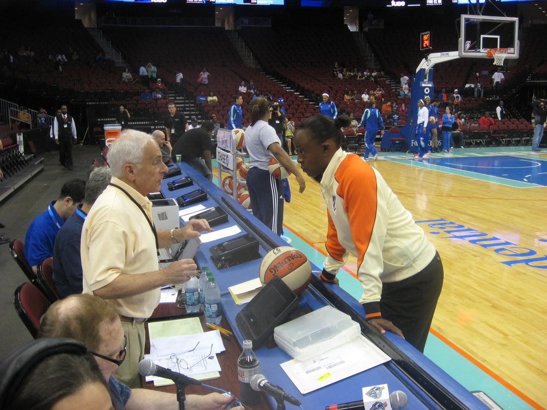 Official Denise Brroks has a pre-game chat with the official scorer at the Prudential Center before the New York Liberty's 87-72 win on Sunday. <em>Photo by Ray Floriani. </em>