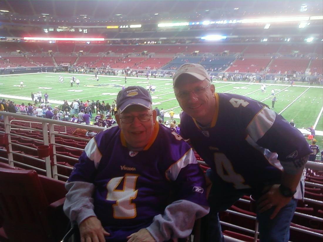 My Dad and I at the Vikings-Rams game, 2009.
