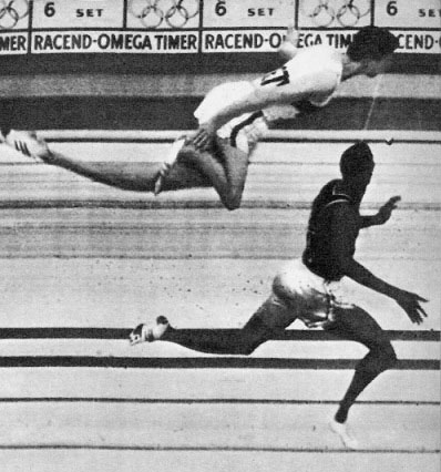 The photo finish 400 meter race at the 1960 Rome Olympics. West Germany's Carl Kaufmann lunges for the finish line in a vain attempt to snatch victory from USA's Otis Davis.