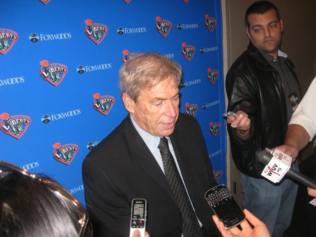 New York Liberty coach John Whisenant meets the media after a 74-64 loss to the Atlanta Dream on Sunday. <em>Photo by Ray Floriani.</em>