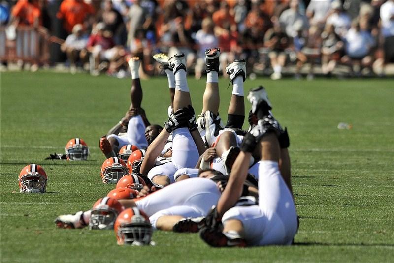 Players stretch during Cleveland Browns training camp at the Cleveland Browns training facility. Mandatory Credit: David Richard-US PRESSWIRE