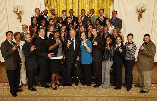 George W. Bush, standing with the ASU men's and women's track and field team in 2008. The former leader of the free world is cool with the pitchfork. (Photo by Eric Draper / The White House)