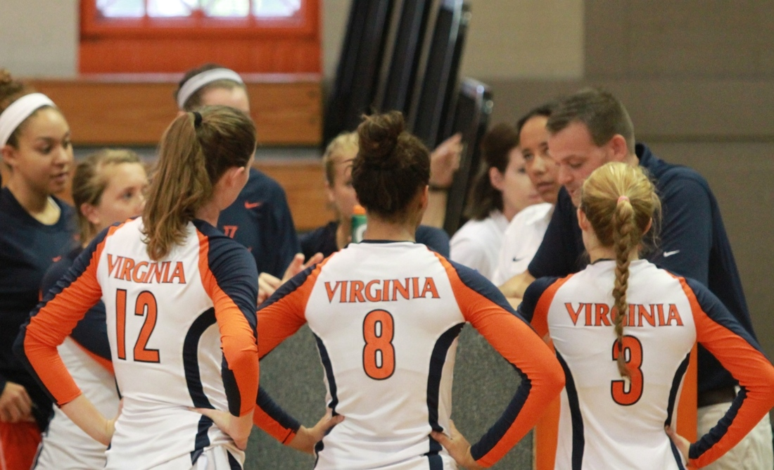 Virginia Volleyball Natalie Bausback (#12), Tori Janowski (#8) and Sydney Shelton (#3) and their teammates listen to Coach Dennis Hohenshelt during a timeout in the Orange and Blue Scrimmage on August 18, 2012. Photo by Tim Mulholland