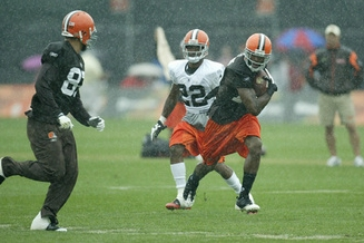 The Browns had a light practice in the rain Saturday before their scrimmage Sunday at the stadium. Here, WR Braylon Edwards goes past CB Brandon McDonald.