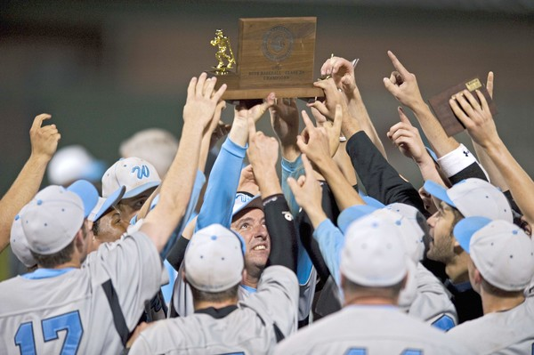 C.M. Wright lifts the Maryland 3A Title trophy after a 4-1 victory over Huntington. Photo via the Baltimore Sun.