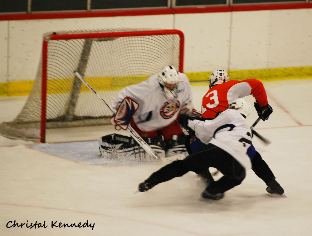 <em>Kerdiles (13 in orange) driving the net.</em>  PHOTO BY Christal Kennedy. All rights reserved. Reproduced with permission. No rights reserved to Anaheim Calling, SB Nation or their associates.
