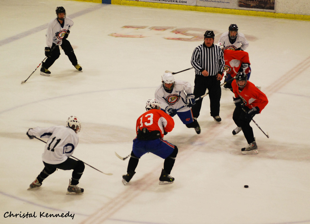 <em>Tyler Moy (center in white) pursuing the puck after a faceoff.</em> PHOTO BY Christal Kennedy. All rights reserved. Reproduced with permission. No rights reserved to Anaheim Calling or SB Nation