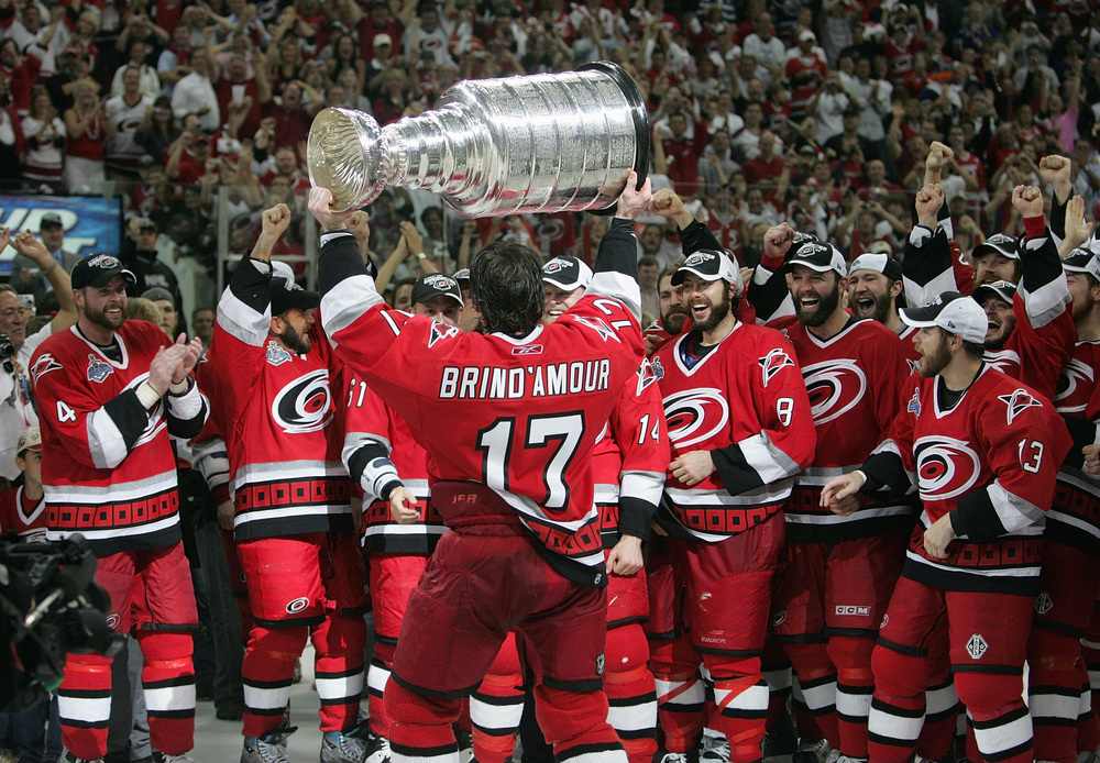 Rod Brind'Amour hoists the Stanley Cup in front of his teammates after the Hurricanes defeated the Edmonton Oilers in game seven of the 2006 NHL Stanley Cup Finals on June 19, 2006. (Photo by Jim McIsaac/Getty Images)