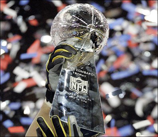 The Lombardi Trophy showered by victorious confetti.