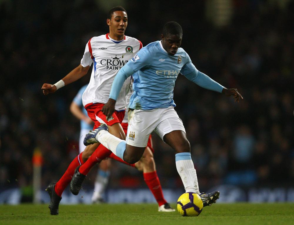 Micah Richards advances the ball against Blackburn last year. (Alex Livesy - Getty Images)