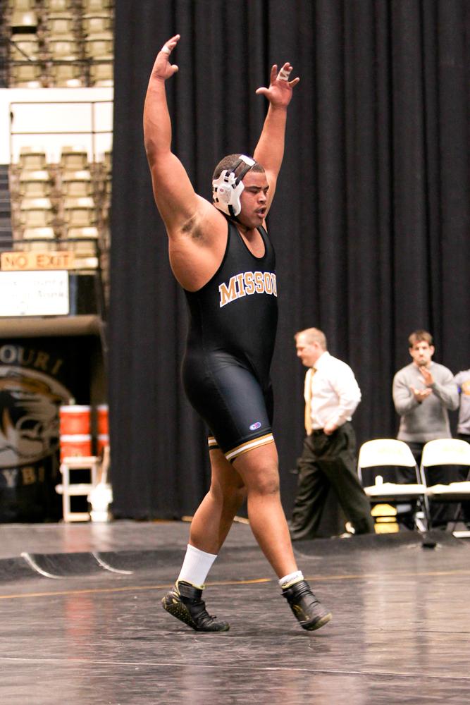 Dom Bradley's next step: walking onto the Gymnastics team.  Photos via Bill Carter (of course).