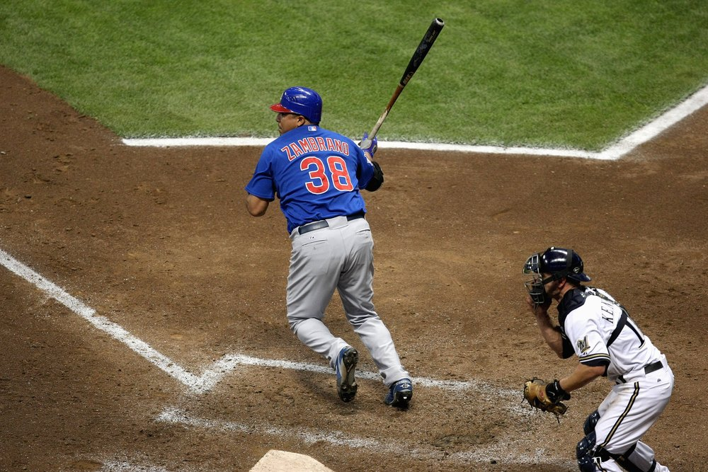 Carlos Zambrano of the Chicago Cubs bats during a game against the Milwaukee Brewers at Miller Park in Milwaukee, Wisconsin. (Photo by Jonathan Daniel/Getty Images)