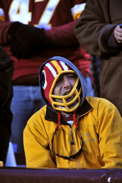 LANDOVER, MD - DECEMBER 6: A fan of the Washington Redskins sits dejected after the late game missed field goal against the New Orleans Saints at FedExField on December 6, 2009 in Landover, Maryland