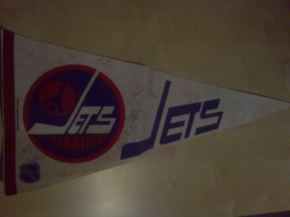 A family friend got the entire 1986-87 team to sign this pennant for me.  Best gift ever!