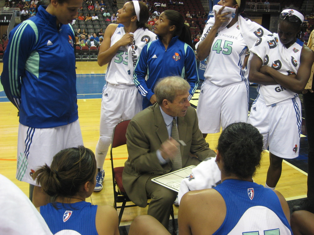 New York Liberty coach John Whisenant goes over a few things during a time out in their 69-66 win over the Washington Mystics yesterday. <em>Photo by Ray Floriani.</em>