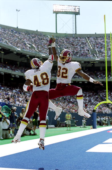 Stephen Davis #48 of the Washington Redskins celebrates with teammate Michael Westbrook #82 in the end zone during the game against the New York Giants at Giants Stadium in East Rutherford, New Jersey. The Redskins defeated the Giants 50-21.