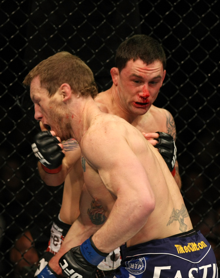 LAS VEGAS - JANUARY 01: (R-L) Frankie Edgar punches Gray Maynard at UFC 125: Resolution at the MGM Grand Garden Arena on January 1, 2011 in Las Vegas, Nevada. (Photo by Donald Miralle/Zuffa LLC/Zuffa LLC via Getty Images)