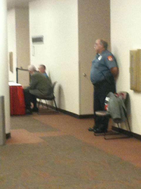 """Image via <a href=""""http://twitter.com/#!/toddtumminia"""" target=""""new"""">KOMU's Todd Tumminia on Twitter</a>. No DOOR, but ... an awfully Wilford Brimley-looking guard protecting the curators from the unruly mob of ... a few people."""