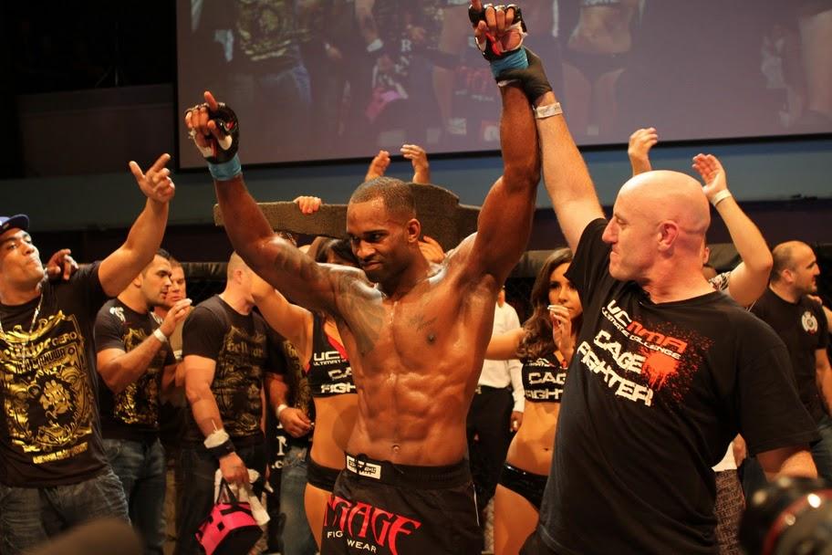 Jimi Manuwa celebrates after defeating Valentino Petrescu for the light heavyweight title at UCMMA 14. (Photo courtesy of RingPics)