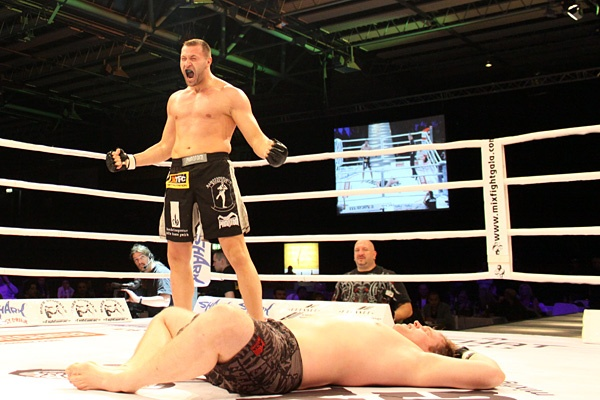 Andreas Kraniotakes stands over Thorsten Kronz at Tempel Mix Fight Gala 11. (Photo by T. Leidecker via Sherdog.com)