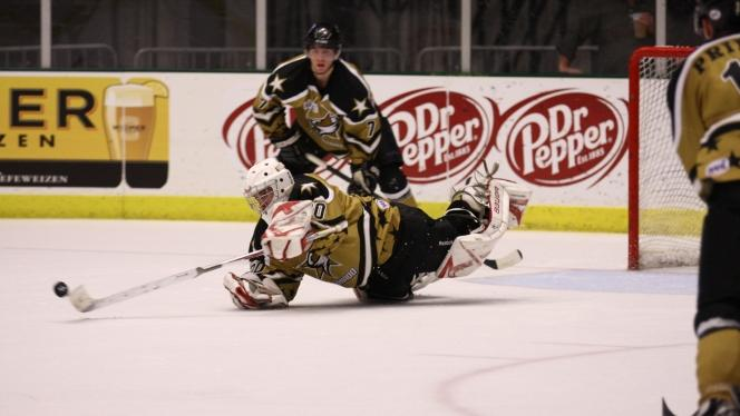 Tornado goalie Joakim Jutras lunges to save the game