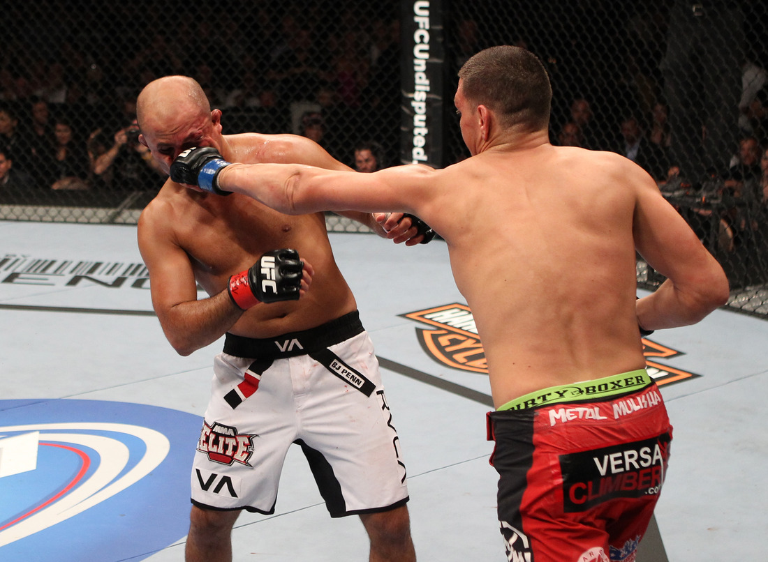 LAS VEGAS, NV - OCTOBER 29: Nick Diaz (red shorts) punches BJ Penn during the UFC 137 event at the Mandalay Bay Events Center on October 29, 2011 in Las Vegas, Nevada. Photo by Jed Jacobsohn/Zuffa LLC/Zuffa LLC via Getty Images.